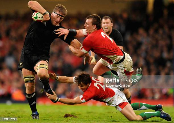 Brad Thorn of New Zealand breaks past Matthew Rees and Martin Roberts of Wales during the Invesco Perpetual Series Match between Wales and New...