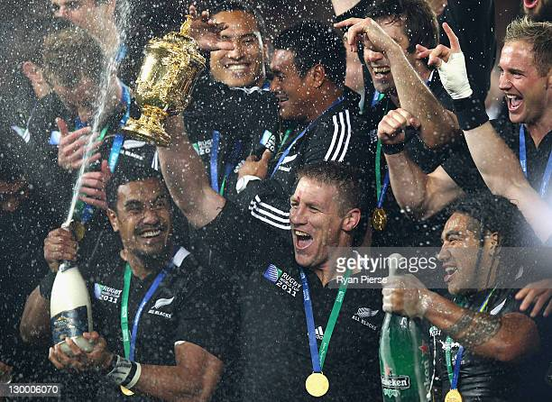 Brad Thorn of the All Blacks celebrates victory with the Webb Ellis trophy in the 2011 IRB Rugby World Cup Final match between France and New Zealand...