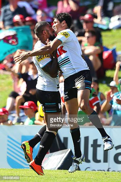 Brad Tighe of the Panthers celebrates with team mate Wes Naiqama after scoring a try during the round three NRL match between the Penrith Panthers...