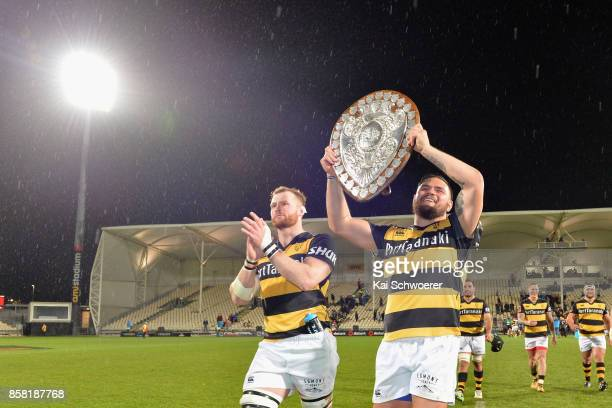 Brad Tucker and Angus Ta'avao of Taranaki present the Ranfurly Shield after their win in the round eight Mitre 10 Cup match between Canterbury and...