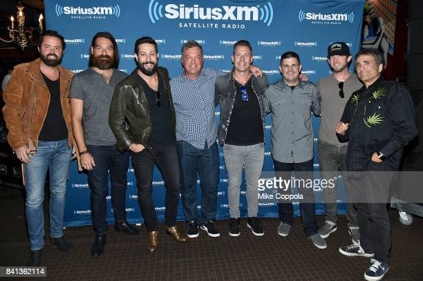 Brad Tursi Geoff Sprung Matthew Ramsey Buzz Brainard Trevor Rosen Al Skop Whit Sellers and Steve Leeds of Old Dominion pose before a private concert...