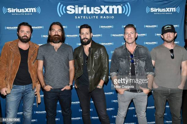 Brad Tursi Geoff Sprung Matthew Ramsey Trevor Rosen and Whit Sellers of Old Dominion pose before a private concert for SiriusXM at The Cutting Room...