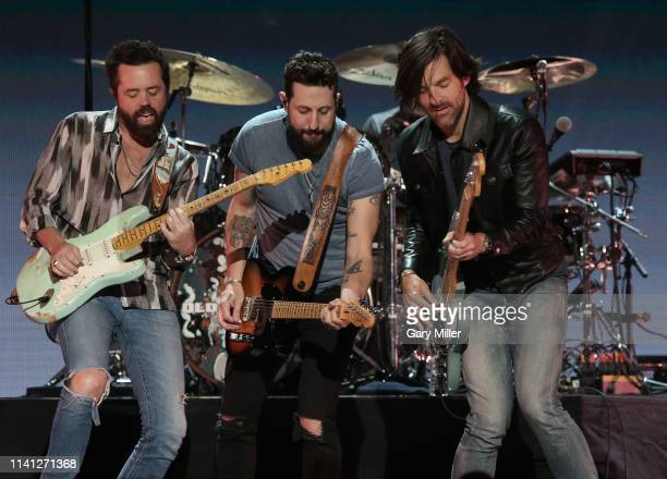 Brad Tursi Matthew Ramsey and Geoff Sprung of Old Dominion perform onstage during the 2019 iHeartCountry Festival Presented by Capital One at the...