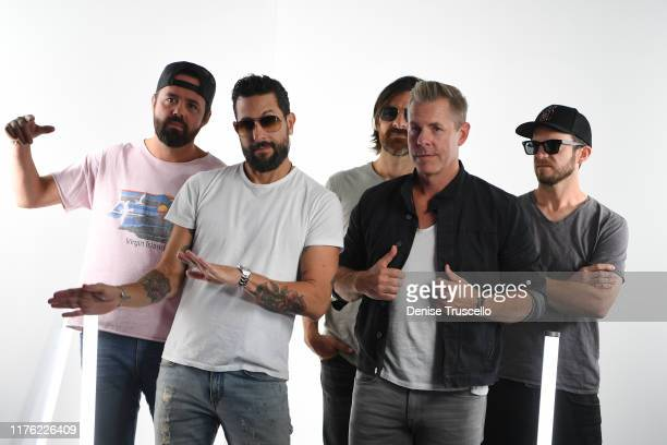 Brad Tursi Matthew Ramsey Geoff Spring Trevor Rosen and Whit Sellers perform attend the Daytime Stage at the 2019 iHeartRadio Music Festival held at...