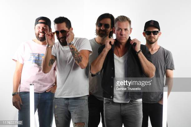 Brad Tursi Matthew Ramsey Geoff Sprung Trevor Rosen and Whit Sellers perform attend the Daytime Stage at the 2019 iHeartRadio Music Festival held at...