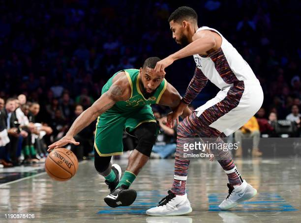 Brad Wanamaker of the Boston Celtics drives past Garrett Temple of the Brooklyn Nets during the first half of their game at Barclays Center on...