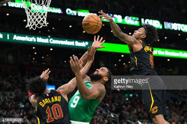 Brad Wanamaker of the Boston Celtics is fouled by Darius Garland and Kevin Porter Jr. #4 of the Cleveland Cavaliers in the first half at TD Garden on...