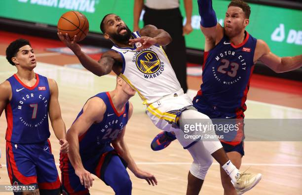 Brad Wanamaker of the Golden State Warriors tries to get a shot off next to Blake Griffin of the Detroit Pistons during the first half at Little...