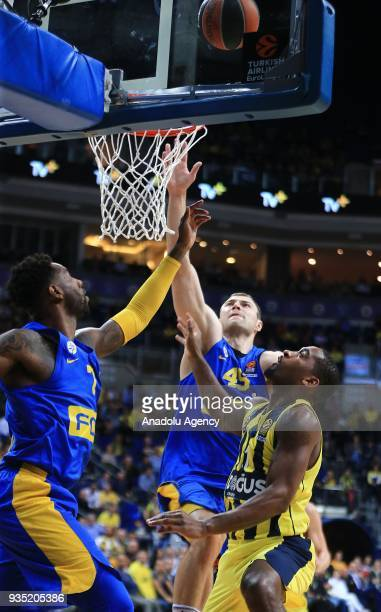 Brad Wannamaker of Fenerbahce Dogus in action against Deandre Kane and Artsiom Parakhouski of Maccabi Fox during the Turkish Airlines Euroleague week...