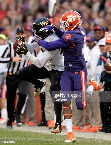 Brad Watson of the Wake Forest Deamon Deacons intercepts a pass over Deon Cain of the Clemson Tigers during their game at Memorial Stadium on...