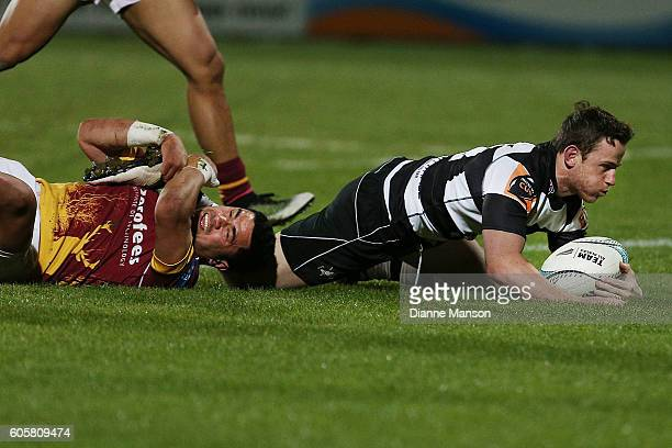 Brad Weber of Hawkes Bay dives over to score a try during the round five Mitre 10 Cup match between Southland v Hawke's Bay at Rugby Park Stadium on...