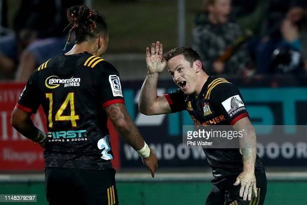 Brad Weber of the Chiefs celebrates his try with Sean Wainui during the round 13 match between the Chiefs and the Sharks at FMG Stadium on May 11...