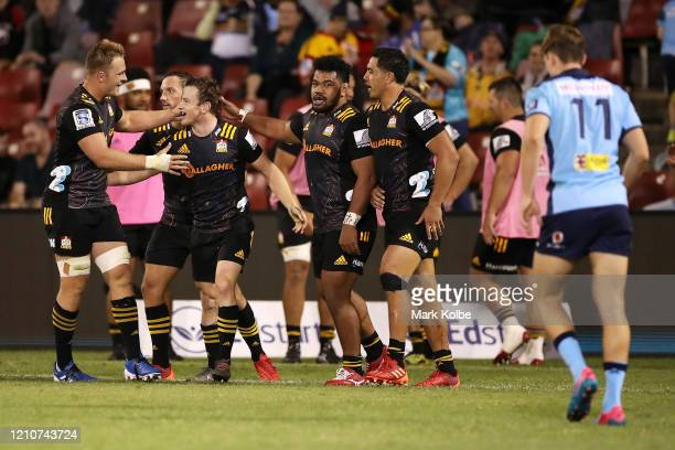 Brad Weber of the Chiefs celebrates with his team mates after scoring a try during the round six Super Rugby match between the Waratahs and the...
