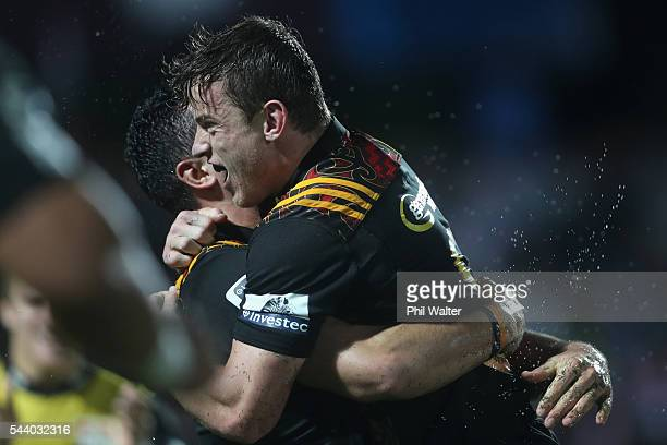 Brad Weber of the Chiefs congratulates James Lowe on his try during the round 15 Super Rugby match between the Chiefs and the Crusaders at ANZ...