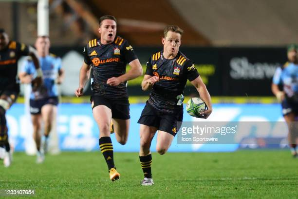 Brad Weber of the Chiefs makes a break during the round five Super Rugby Trans Tasman match between the NSW Waratahs and Chiefs at Brookvale Oval on...
