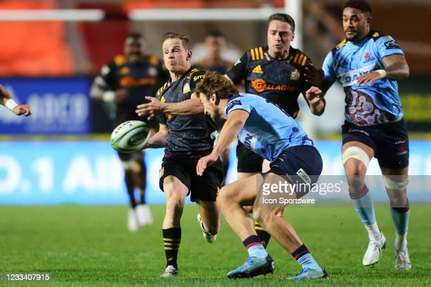 Brad Weber of the Chiefs passes the ball during the round five Super Rugby Trans Tasman match between the NSW Waratahs and Chiefs at Brookvale Oval...