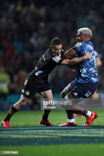 Brad Weber of the Chiefs tackles Hoskins Sotutu of the Blues during the round 2 Super Rugby Aotearoa match between the Chiefs and the Blues at FMG...
