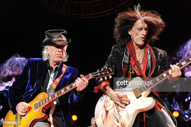 Brad Whitford and Joe Perry of Aerosmith perform during The Global Warming Tour at ORACLE Arena on August 4 2012 in Oakland California