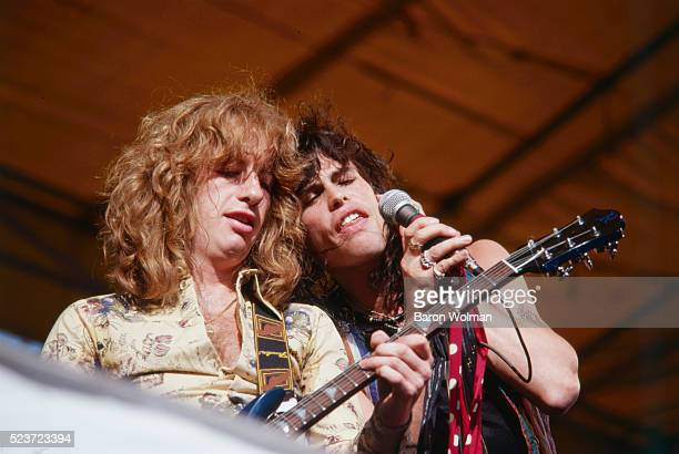 Brad Whitford and Steven Tyler from American rock band Aerosmith play on stage at the Day of the Green concert Oakland California July 1978#10