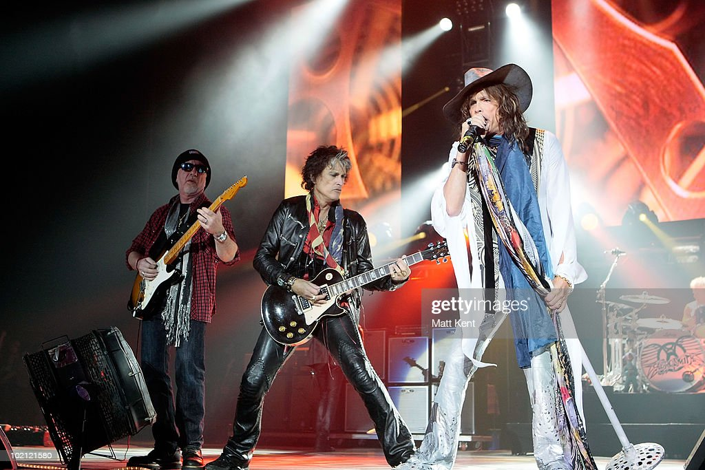 Brad Whitford, Joe Perry and Steven Tyler of Aerosmith perform at 02 Arena on June 15, 2010 in London, England.