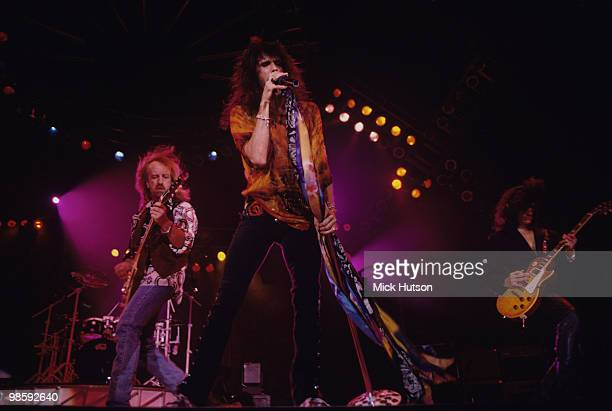 Brad Whitford Steven Tyler and Joe Perry of Aerosmith perform on stage at Wembley Arena in London England on December 07 1993