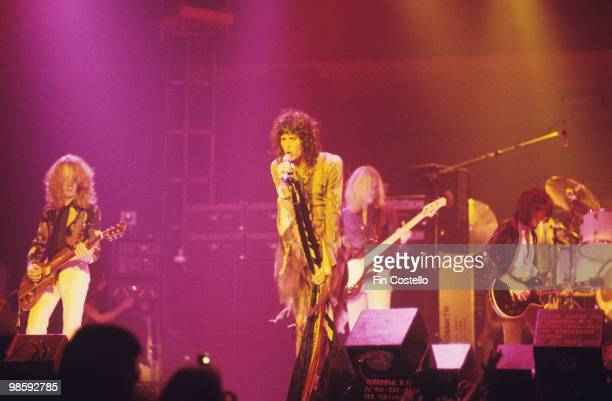 Brad Whitford, Steven Tyler, Tom Hamilton and Joe Perry of Aerosmith perform on stage at the Providence Civic Center in Rhode Island on October 27,...