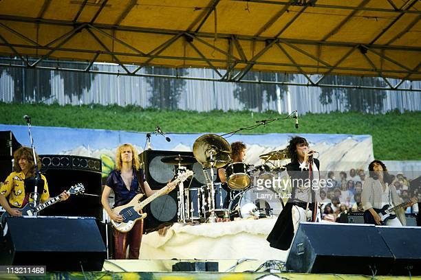 Brad Whitford Tom Hamilton Joey Kramer Stephen Tyler and Joe Perry of Aerosmith performing at the Oakland Coliseum in Oakland California on July 21...