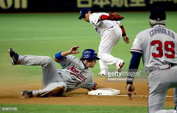 Brad Wilkerson of the Montreal Expos slides into second base during the 1st game of the exhibition series between US MLB and Japanese Professional...