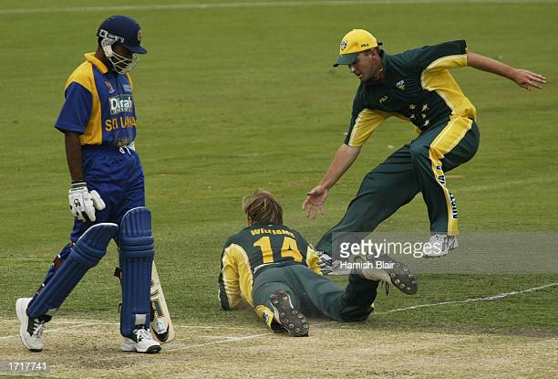 Brad Williams of Australia A dives in an unsuccessful attempt to catch Mahela Jayawardene of Sri Lanka with Nathan Hauritz of Australia A looking on...