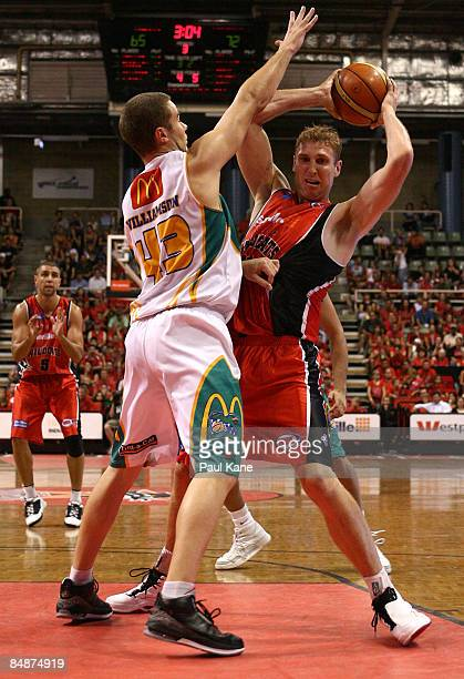 Brad Williamson of the Crocodiles blocks Shawn Redhage of the Wildcats during the NBL quarter final match between the Perth Wildcats and the...