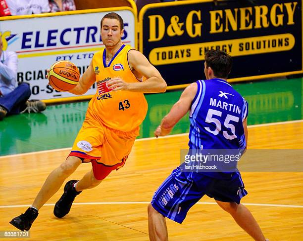 Brad Williamson of the Crocs looks to drive past Damian Martin of the Spirit during the round six NBL match between the Townsville Crocodiles and the...