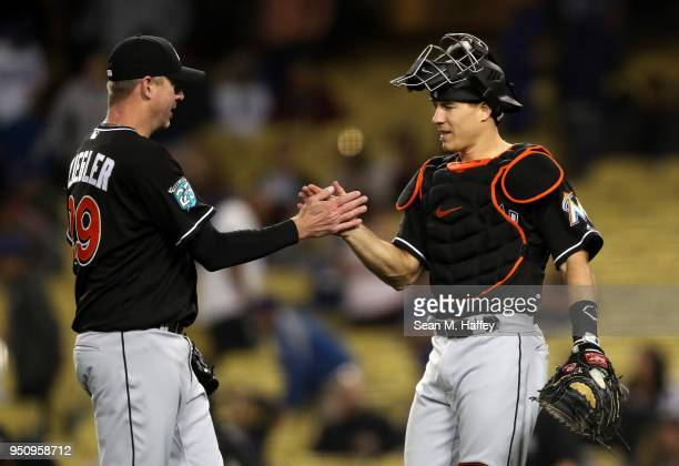 Brad Ziegler and JT Realmuto of the Miami Marlins celebrate defeating the Los Angeles Dodgers 32 in a game at Dodger Stadium on April 24 2018 in Los...