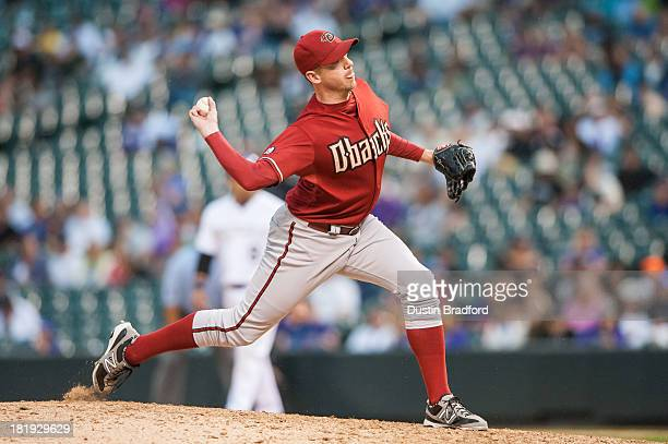 Brad Ziegler of the Arizona Diamondbacks pitches in relief in the ninth inning of a game against the Colorado Rockies at Coors Field on September 22...