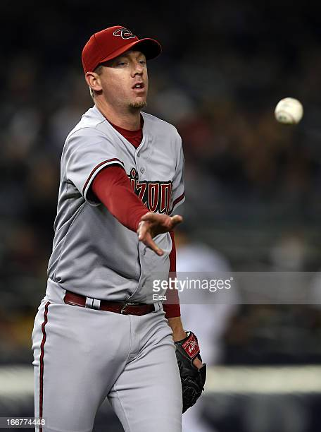 Brad Ziegler of the Arizona Diamondbacks sends the ball to first for the out in the seventh inning against the New York Yankees on April 16 2013 at...