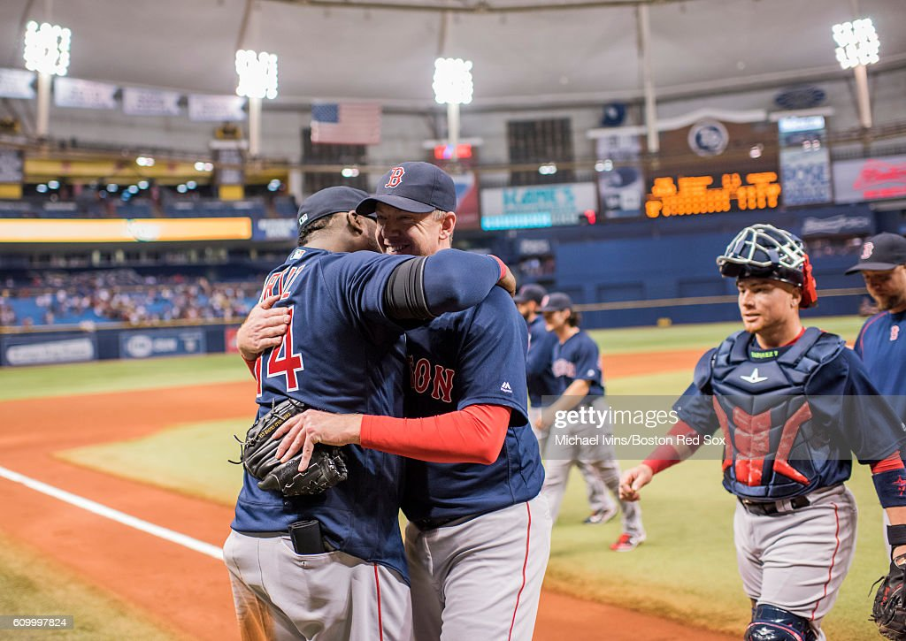 Brad Ziegler #29 of the Boston Red Sox is hugged by David Ortiz #34 after closing out a 2-1 win over the Tampa Bay Rays on September 23, 2016 at Tropicana Field in St. Petersburg, Florida.