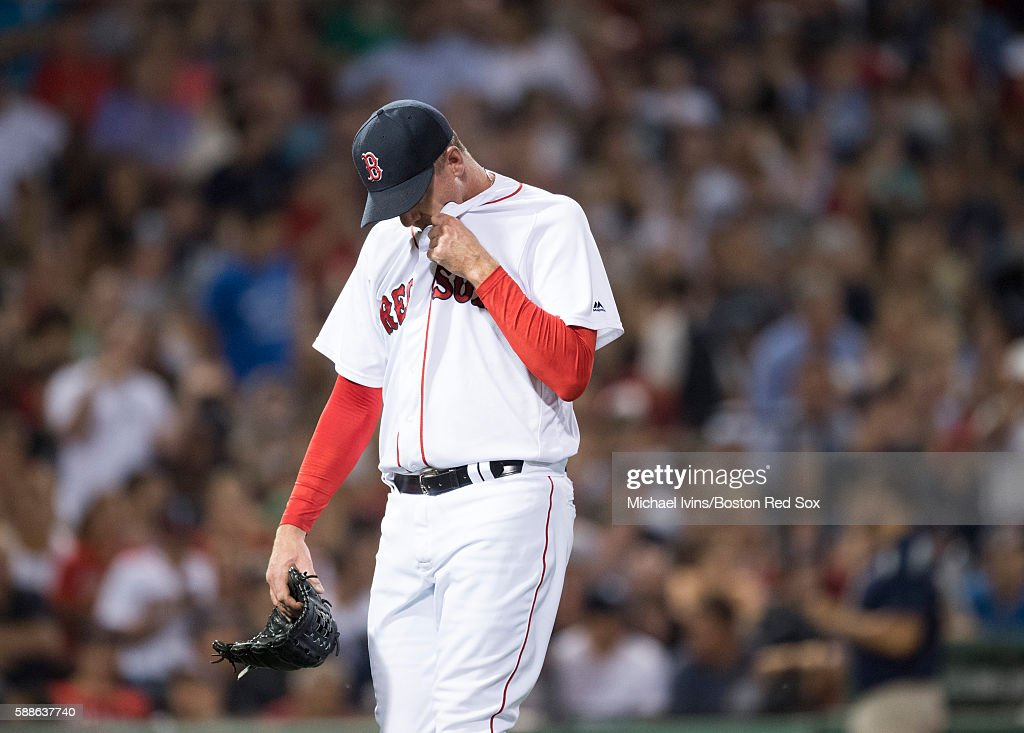 Brad Ziegler #29 of the Boston Red Sox reacts after allowing three runs against the New York Yankees in the eighth inning on August 11, 2016 at Fenway Park in Boston, Massachusetts.