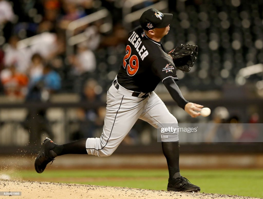 Brad Ziegler #29 of the Miami Marlins delivers a pitch in the ninth inning against the New York Mets on August 18, 2017 at Citi Field in the Flushing neighborhood of the Queens borough of New York City.