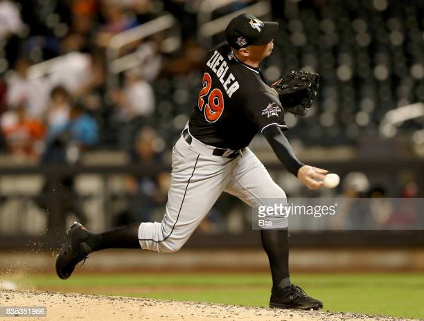 Brad Ziegler of the Miami Marlins delivers a pitch in the ninth inning against the New York Mets on August 18 2017 at Citi Field in the Flushing...