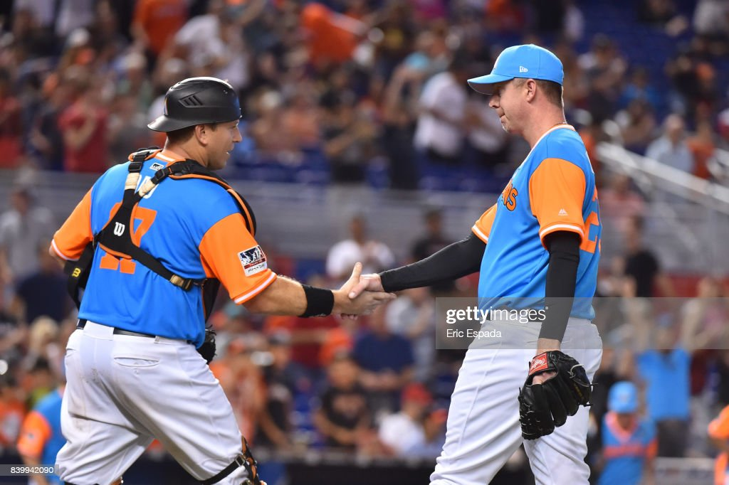 Brad Ziegler #29 of the Miami Marlins is congratulated by A.J. Ellis #17 after defeating the San Diego Padres at Marlins Park on August 27, 2017 in Miami, Florida.