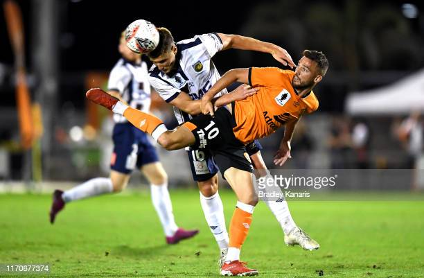 Bradden Inman of the Roar and Dylan Fox of the Mariners challenge for the ball during the round of 16 FFA Cup match between the Brisbane Roar and the...