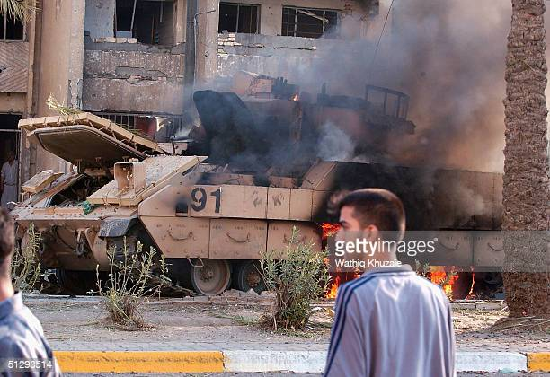 Braddley Armoured Vehicle is seen burning on September 12 2004 in Haifa Street Baghdad Iraq Fighting broke out in the early hours of September 12...