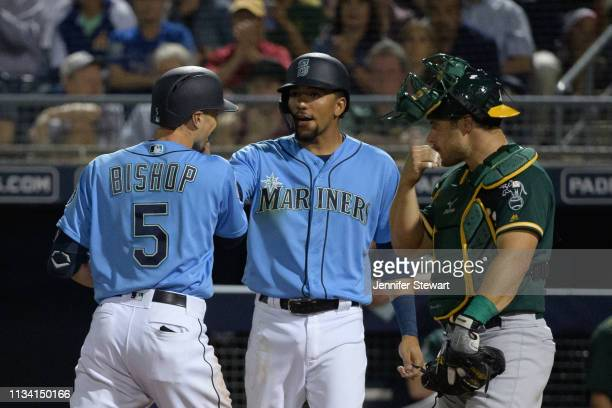 Braden Bishop of the Seattle Mariners is congratulated by J.P. Crawford after hitting a three run home run against the Oakland Athletics during the...