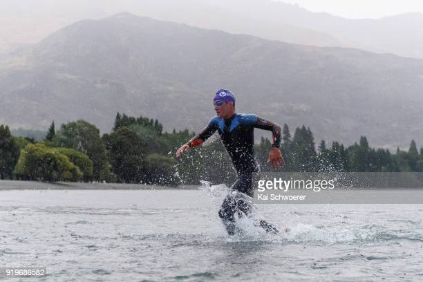 Braden Currie of New Zealand exits the water during 2018 Challenge Wanaka on February 17 2018 in Wanaka New Zealand