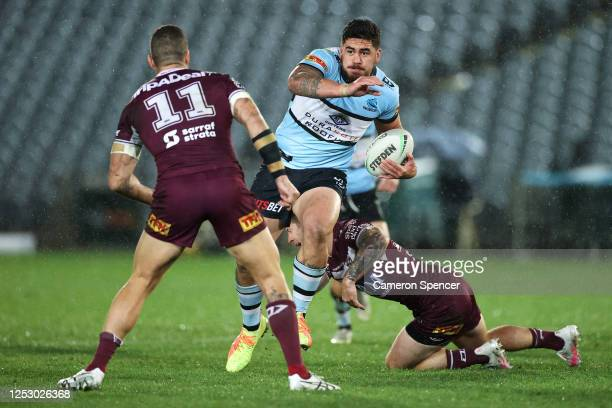 Braden Hamlin-Uele of the Sharks runs the ball during the round seven NRL match between the Manly Sea Eagles and the Cronulla Sharks at Central Coast...