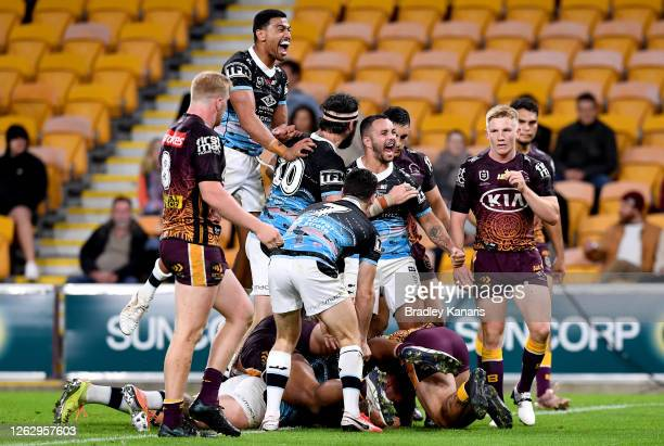 Braden Hamlin-Uele of the Sharks scores a try to seal the win during the round 12 NRL match between the Brisbane Broncos and the Cronulla Sharks on...