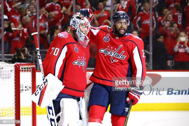 Braden Holtby and Devante SmithPelly of the Washington Capitals celebrate their team's 62 win over the Vegas Golden Knights in Game Four of the 2018...