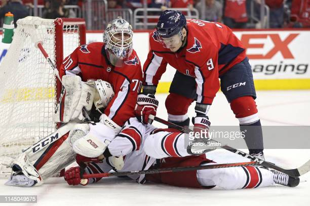 Braden Holtby and Dmitry Orlov of the Washington Capitals combine to check Nino Niederreiter of the Carolina Hurricanes during the third period in...