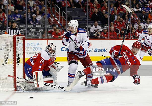 Braden Holtby and Dmitry Orlov of the Washington Capitals defend against Jesper Fast of the New York Rangers during the first period at the Verizon...