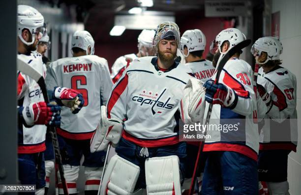 Braden Holtby and Radko Gudas of the Washington Capitals high five before the second period of a Round Robin game during the 2020 NHL Stanley Cup...