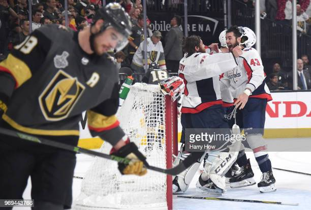 Braden Holtby and Tom Wilson of the Washington Capitals celebrate their 43 winto win the Stanley Cup as Reilly Smith of the Vegas Golden Knights...